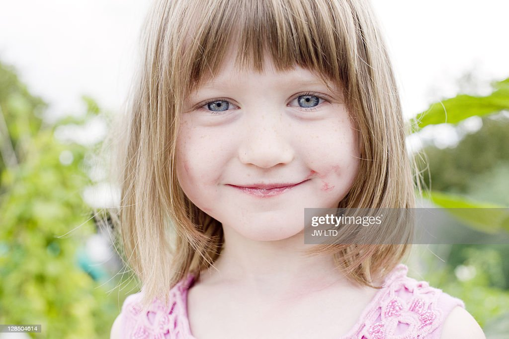 Girl with messy face, portrait : Stock Photo
