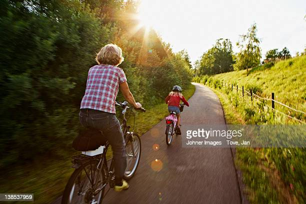 Girl with mother riding bike