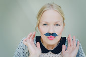 A girl with mustache