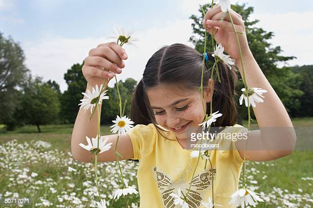 Girl with Necklace of Flowers