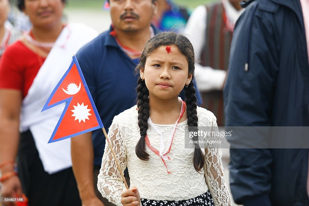 A girl with Nepals national flag takes part in 9th Republic Day parade in Kathmandu, Nepal on May 28, 2016.