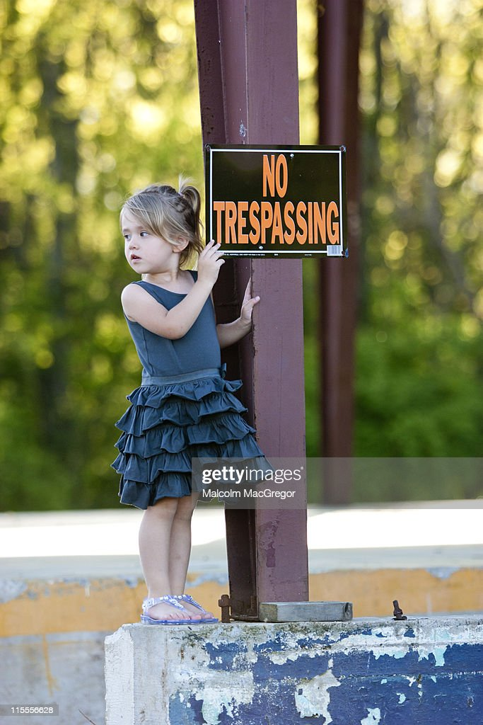 Girl with No Trespassing Sign