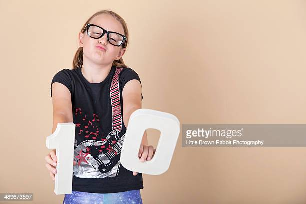 Girl with number 10 and blackk geek glasses