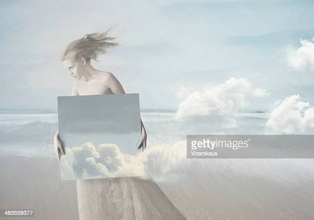 girl with painting of clouds