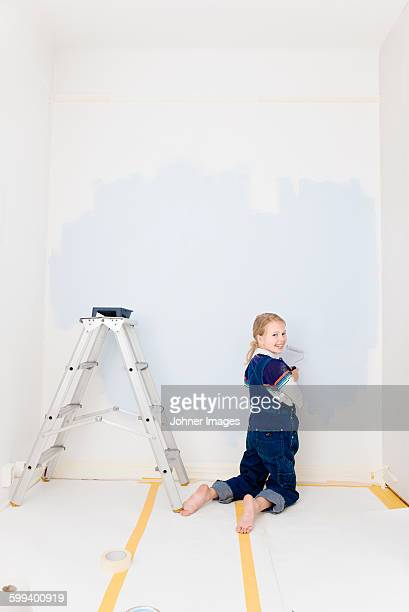 Girl with painting wall