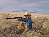 Young girl with pellet gun on prairie in Big Timber, Montana