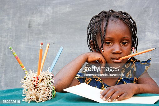 Girl with pencil in the mouth