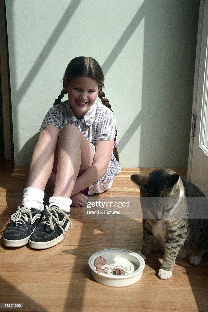 Girl with pet cat : Stock Photo