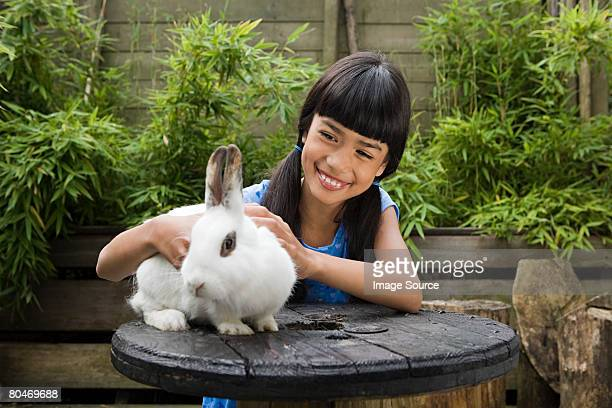 Girl with pet rabbit