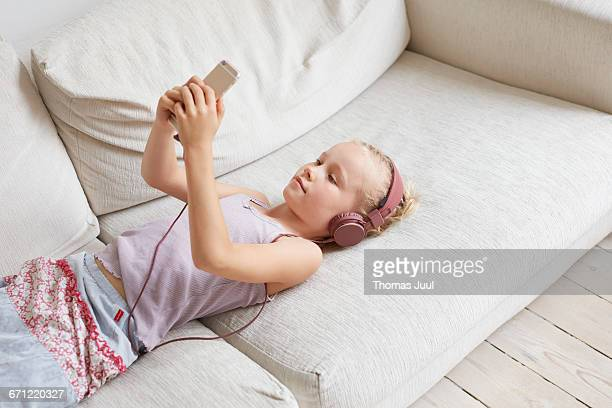 girl with phone in sofa
