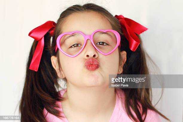 Girl with pigtails sending a kiss