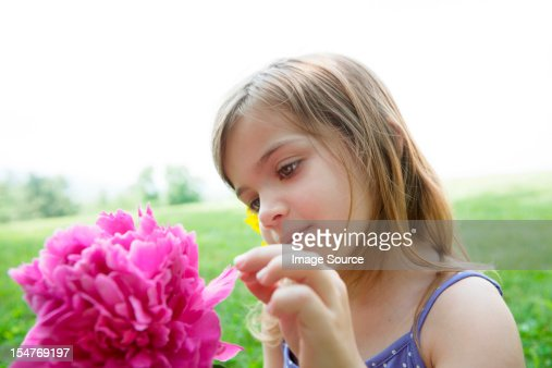 Girl with pink flower : Stock Photo