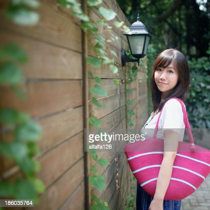 Girl with pink tote : Stock Photo