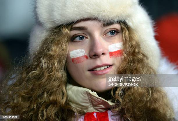 A girl with Polish flag painted on her cheeks follows the 16th World Cup Ski Jumping competition in Zakopane on January 12 2013 AFP PHOTO/JANEK...