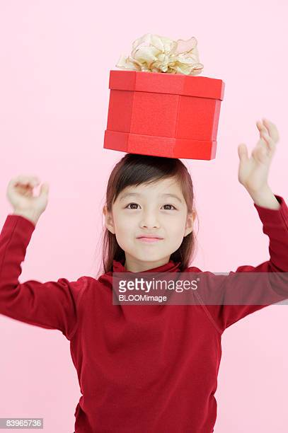 Girl with present box on her head