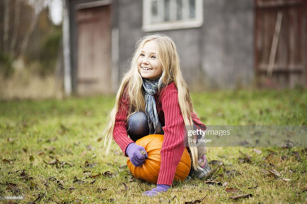 Girl with pumpkin outdoors : Stock Photo