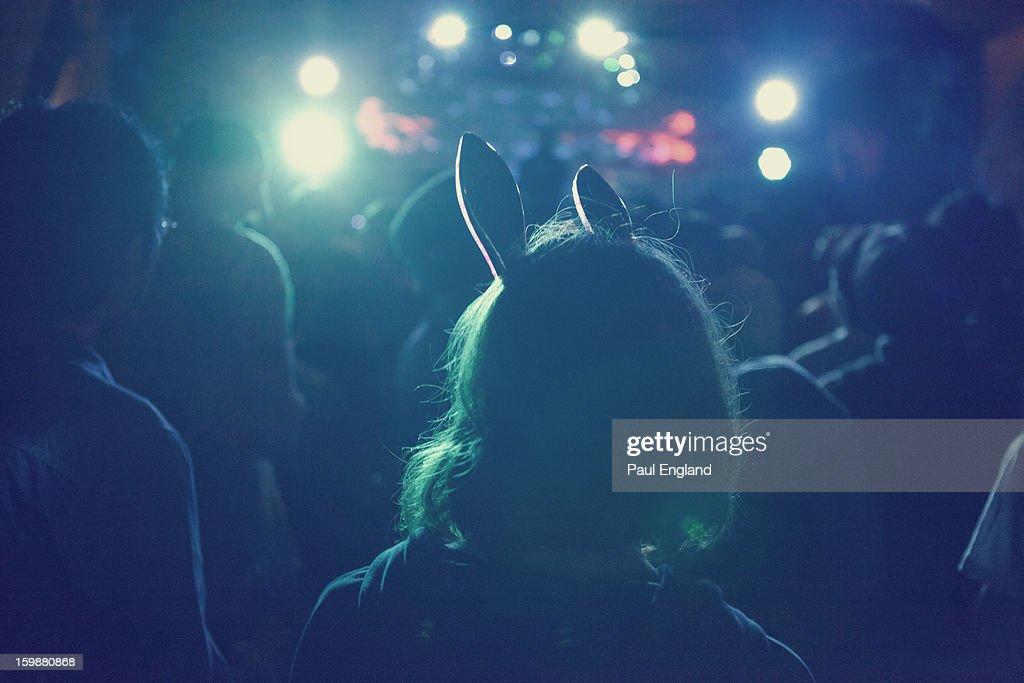 CONTENT] A girl with rabbit ears enjoys a music festival in Tokyo.