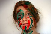 Girl with red and green paint on her face