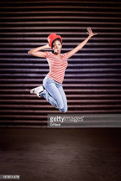 Girl with red hat jumping