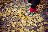 Girl with red socks and green shoes
