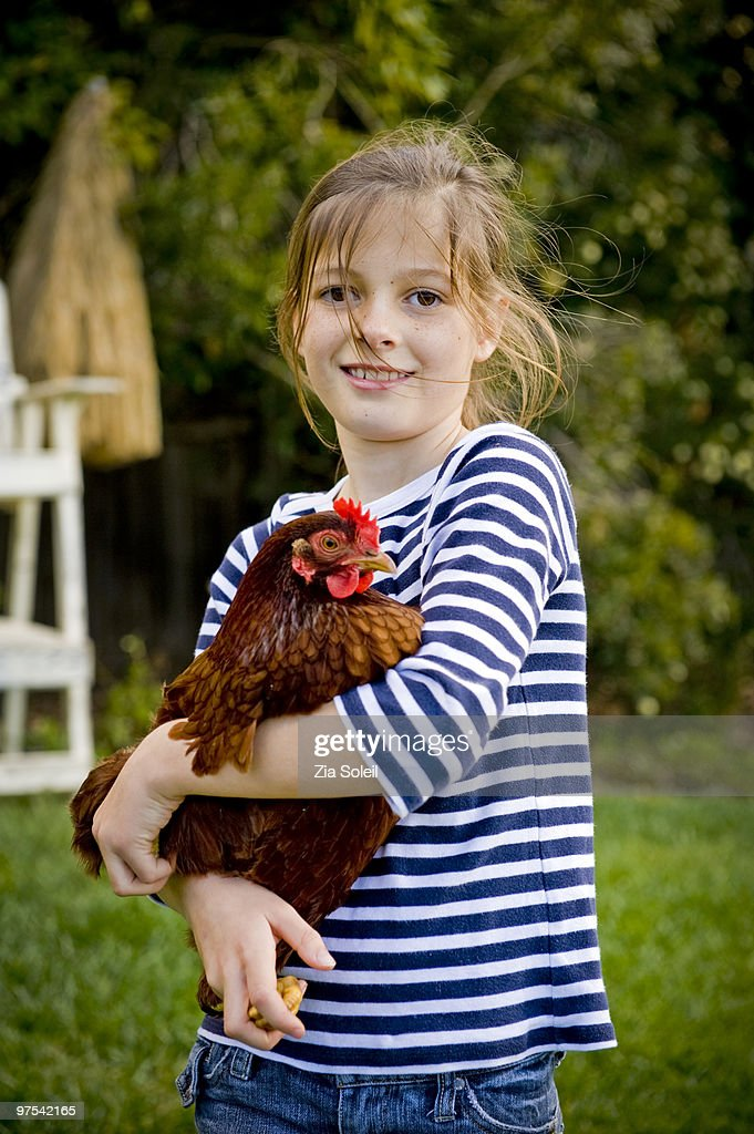 girl with Rhode Island Red chicken