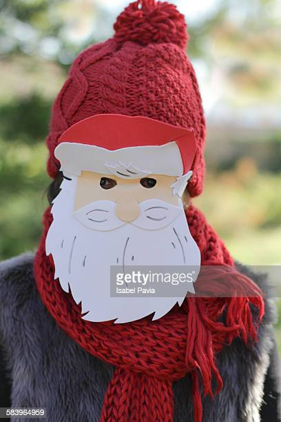 Girl with Santa's mask