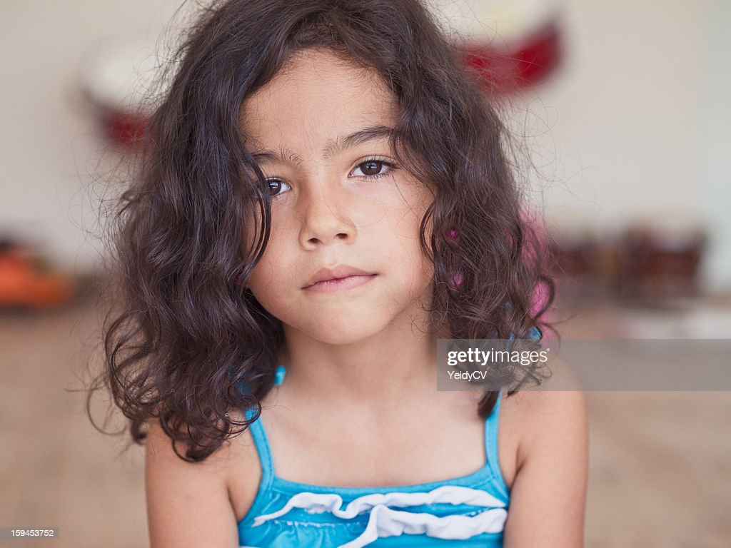 Girl with serious look : Stock Photo