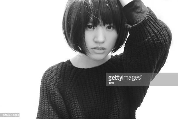 Girl with short hair facing camera