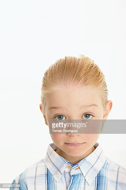 Girl with slicked-back hair and solemn face
