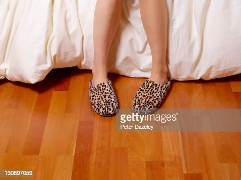 Girl with slippers and copy space : Stock Photo