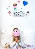 Girl with Smiley Face Balloon