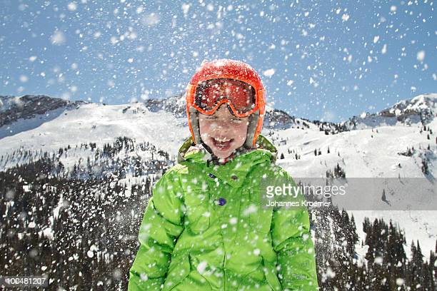 girl with snow thrown at her