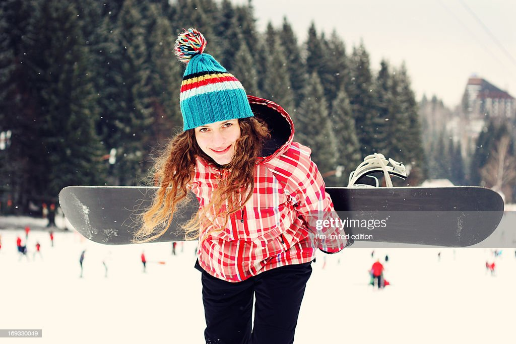Girl with snowboard : Stock Photo