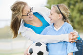 Mom or older sister happy with her young soccer player