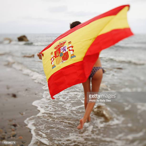 Girl with Spanish flag on beach