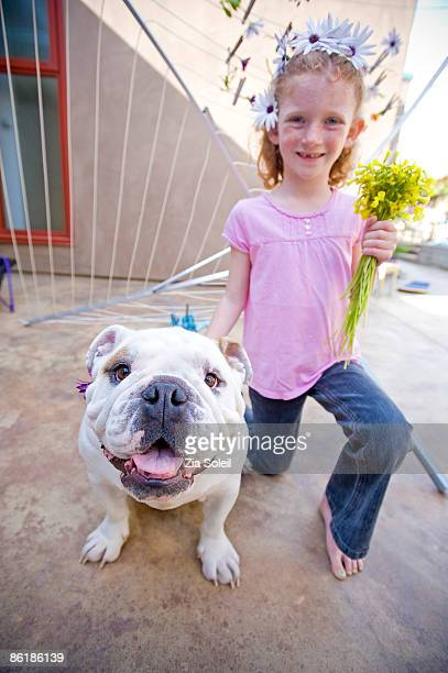 girl with Spring flowers and her bulldog