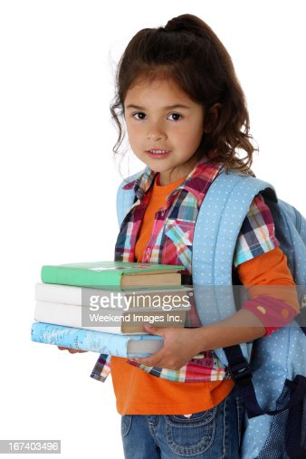 Bambina con la pila di libri di testo : Foto stock