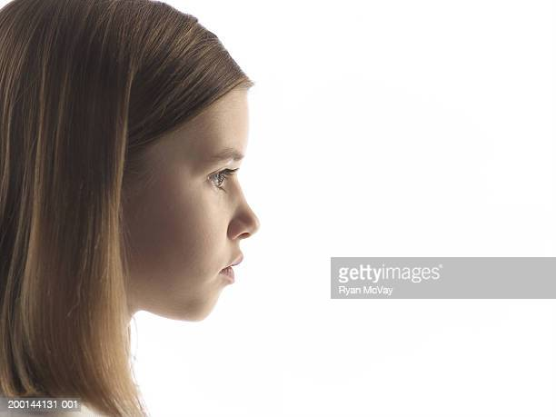 Girl (7-9) with straight hair, profile