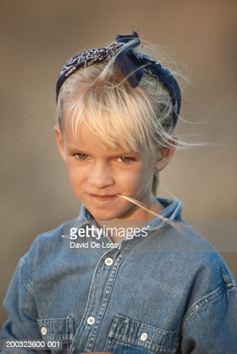 Girl (4-5) with straw in mouth outdoors, portrait : Stock Photo