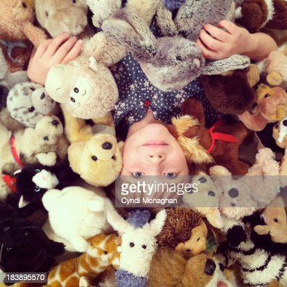 Girl with Stuffed Animals