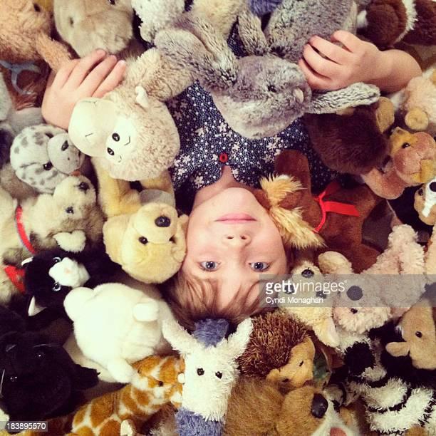 Girl with Stuffed Animals