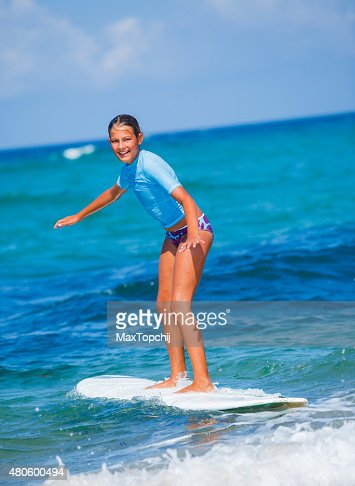 Girl with surf : Stock Photo