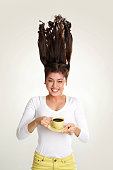 Portrait of young girl with cup of tea on white background