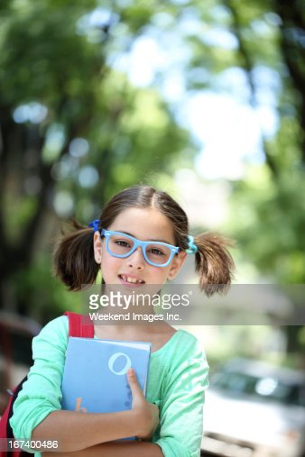 Girl with textbook : Bildbanksbilder