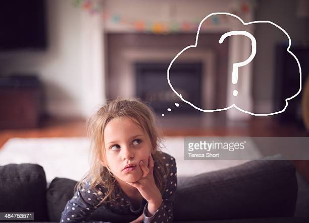 Girl With Thoughtful Expression and Question Mark