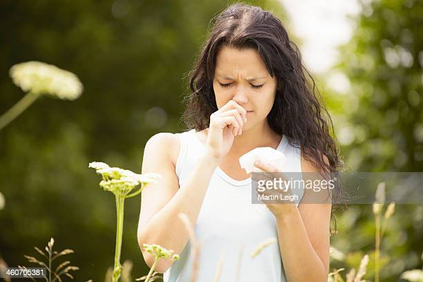 Girl with tissue rubbing nose