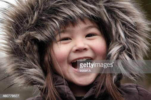 Girl with toothy laugh and furry hoods.