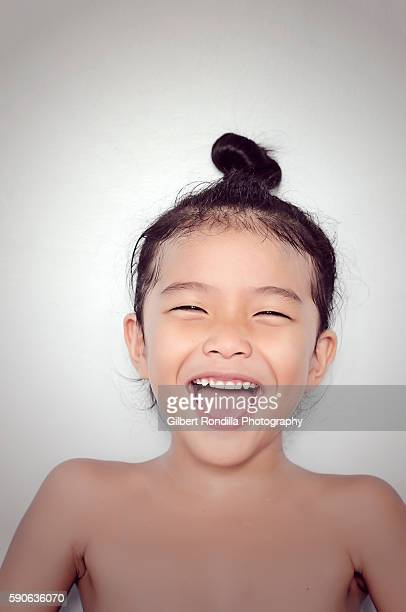 Girl with top bun