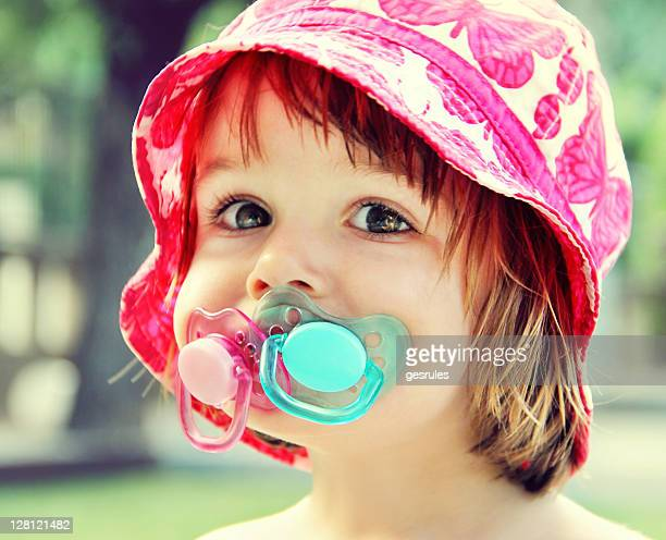 Girl with two pacifiers