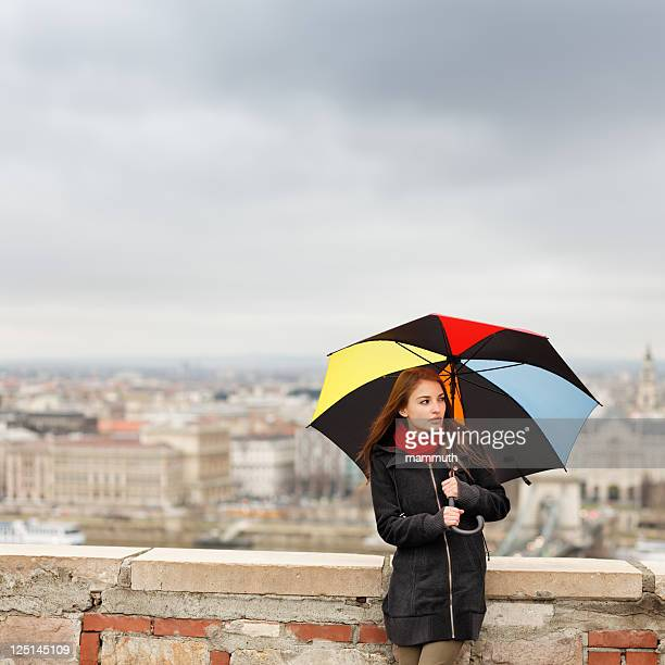 girl with umbrella on a rainy day